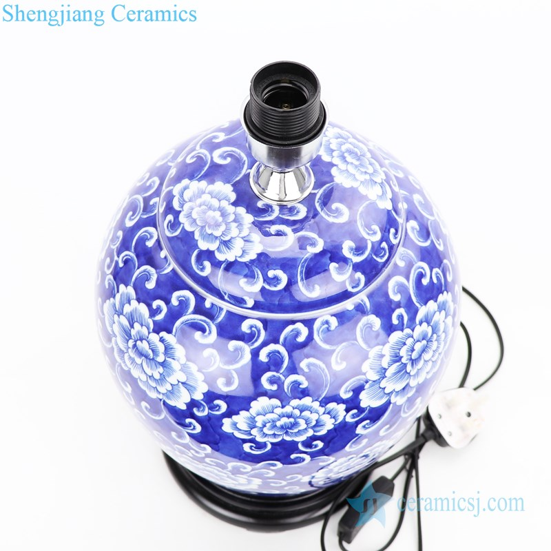 blue background ceramic lamp with flower pattern