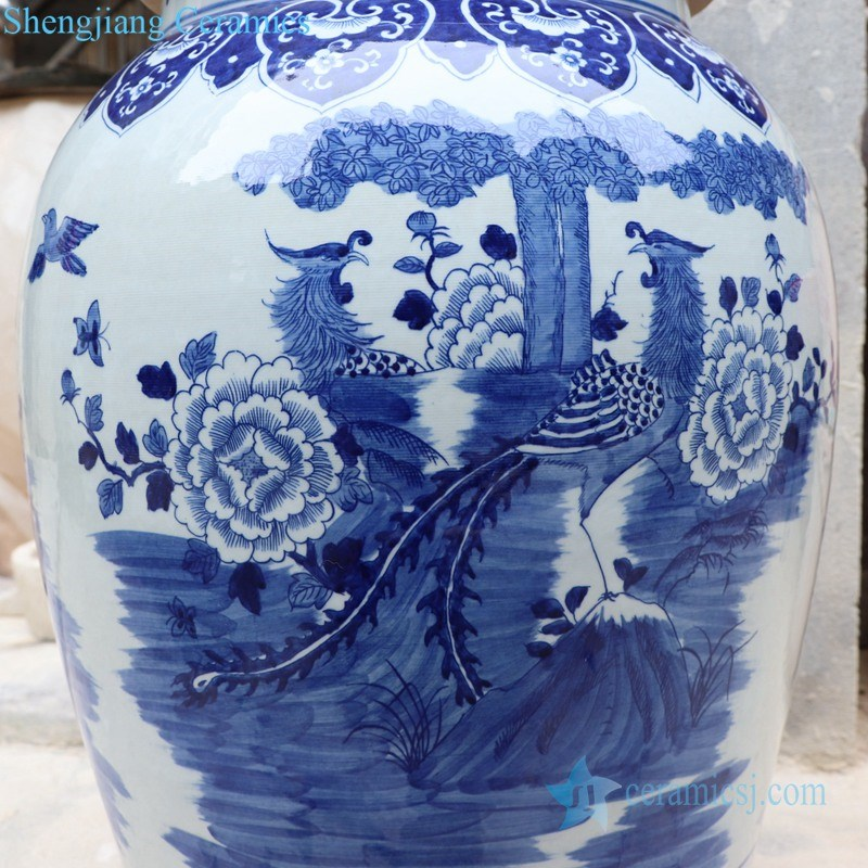 blue and white handmade ceramic jar with lion's head shaped lid