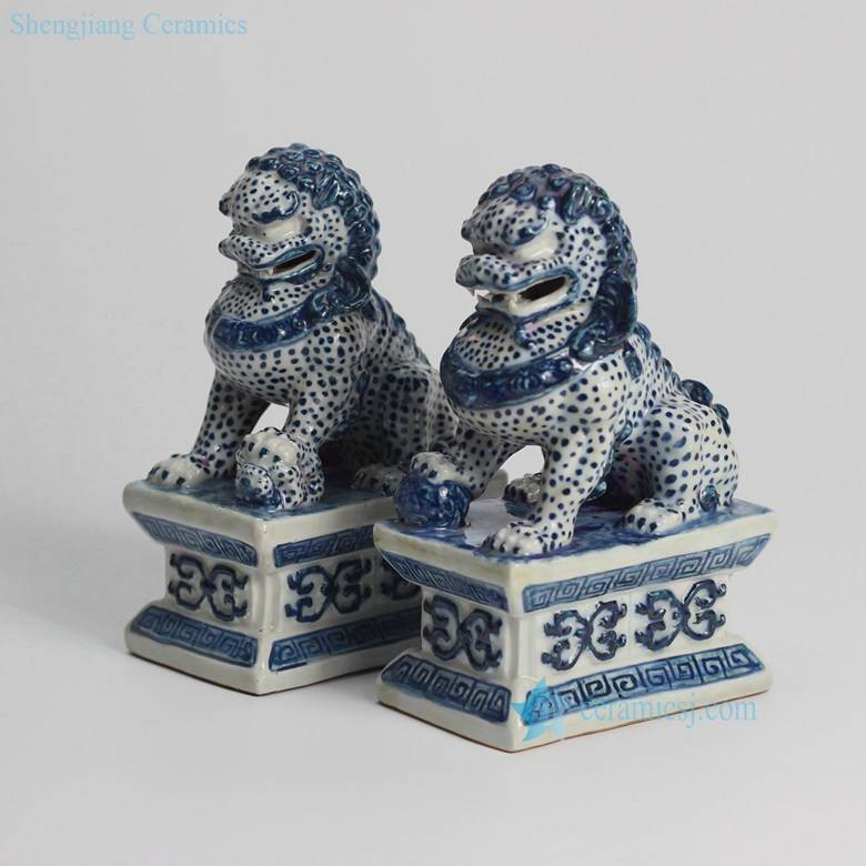 Blue and white pair of ceramic sitting lions book end