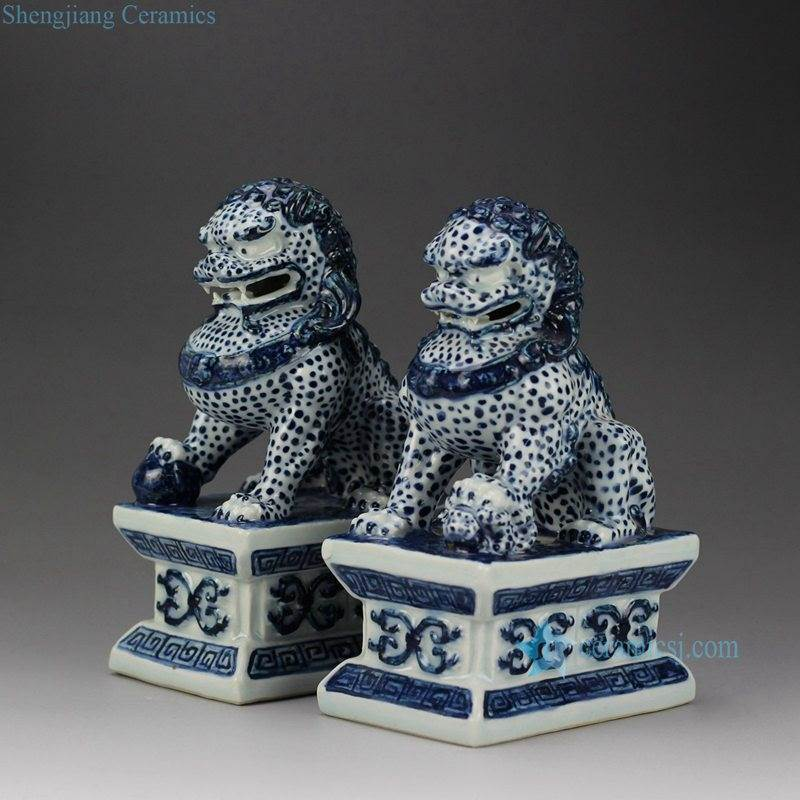 Blue and white handmade  pair of ceramic sitting lions book end