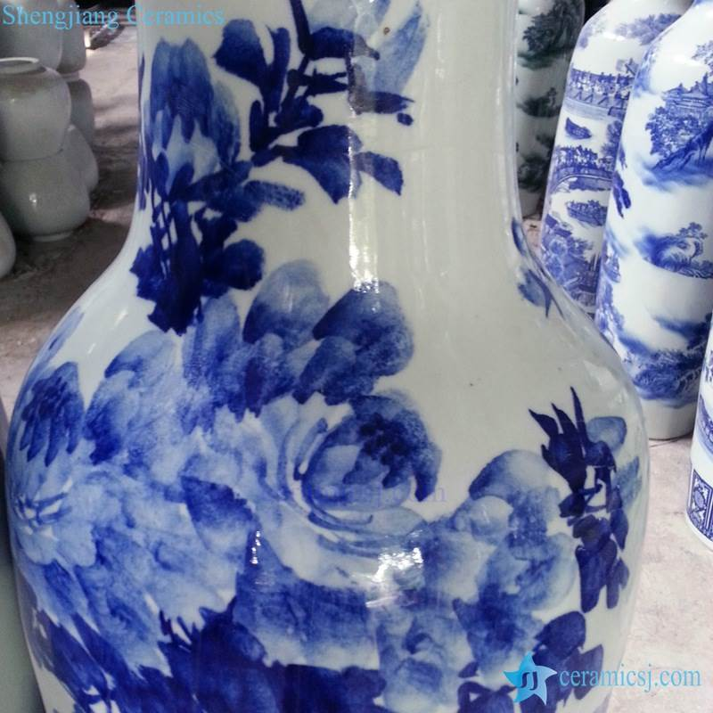 Tall blue and white ceramic vase  with flower pattern